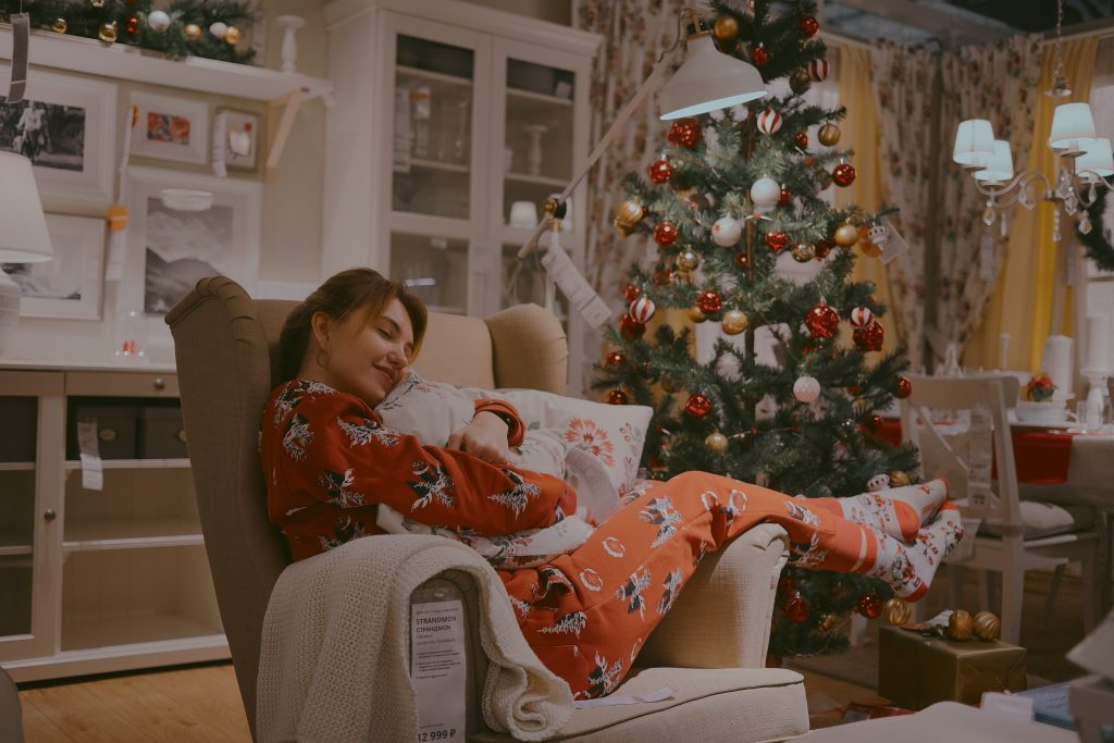 Lady on couch Christmas